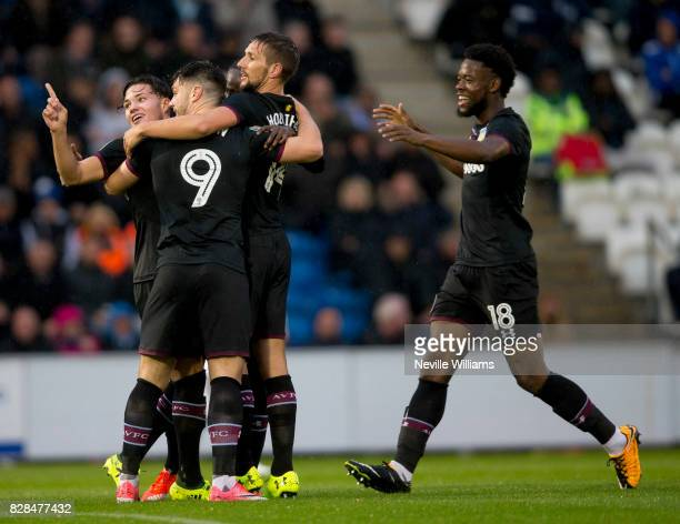 Scott Hogan of Aston Villa celebrates his goal for Aston Villa during the Carabao Cup First Round match between Colchester United and Aston Villa at...