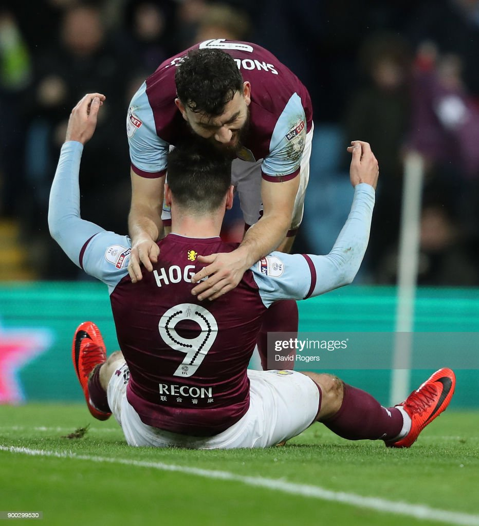 Scott Hogan of Aston Villa celebrates with Robert Snodgrass after scoring their first goal during the Sky Bet Championship match between Aston Villa and Bristol City at Villa Park on January 1, 2018 in Birmingham, England.