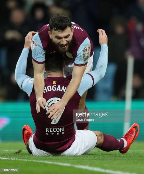 Scott Hogan of Aston Villa celebrates with Robert Snodgrass after scoring their first goal during the Sky Bet Championship match between Aston Villa...