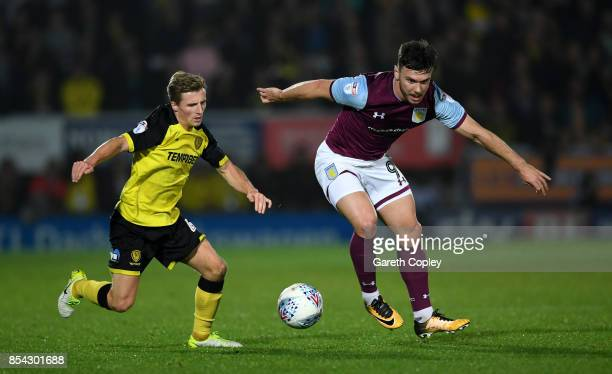 Scott Hogan of Aston Villa gets past Jamie Allen of Burton during the Sky Bet Championship match between Burton Albion and Aston Villa at Pirelli...