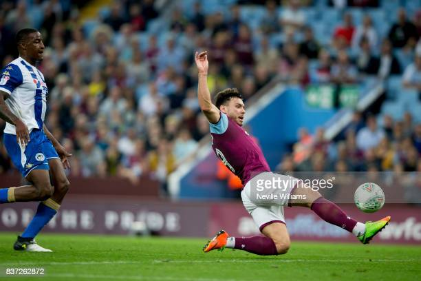 Scott Hogan of Aston Villa scores for Aston Villa during the Carabao Cup Second Round match between Aston Villa and Wigan Athletic at the Villa Park...