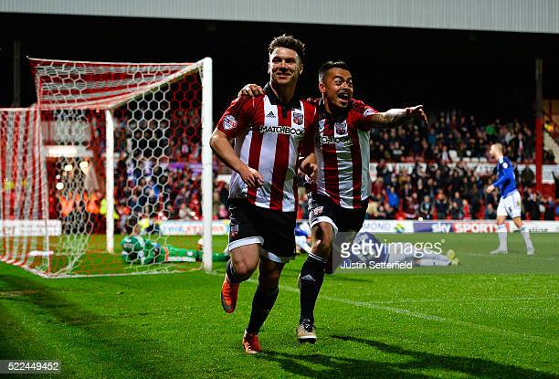 Scott Hogan of Brentford FC celebrates scoring the 1st Brentford goal with Nico Yennaris of Brentford FC during the Sky Bet Championship match...