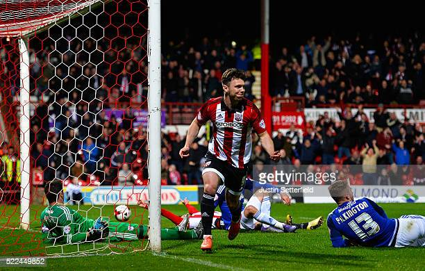 Scott Hogan of Brentford FC celebrates scoring the 1st brentford goal during the Sky Bet Championship match between Brentford and Cardiff City on...