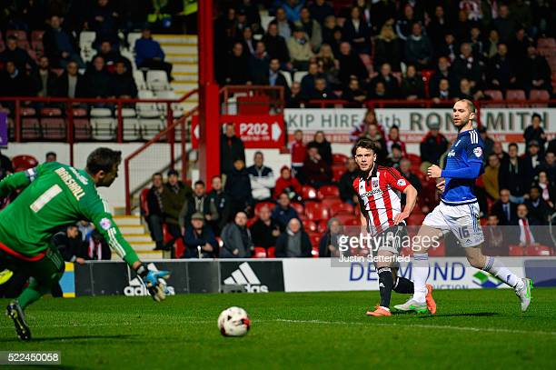 Scott Hogan of Brentford FC scores the 2nd brentford goal during the Sky Bet Championship match between Brentford and Cardiff City on April 19, 2016...