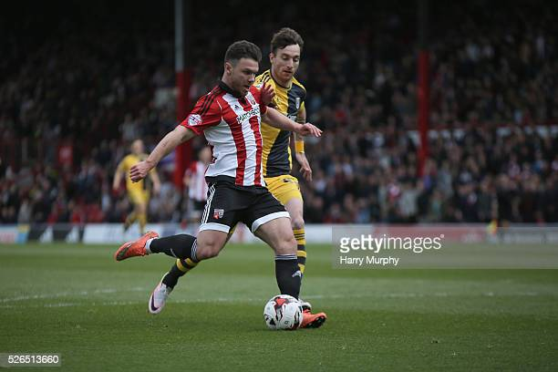 Scott Hogan of Brentford scores their second during the Sky Bet Championship match between Brentford and Fulham at Griffin Park on April 30 2016 in...