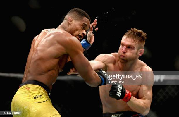 Scott Holtzman knocks down Alan Patrick of Brazil with a punch in their lightweight bout during the UFC 229 event inside TMobile Arena on October 6...