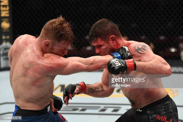 Scott Holtzman punches Jim Miller in their lightweight bout during the UFC Fight Night event at Santa Ana Star Center on February 15, 2020 in Rio...