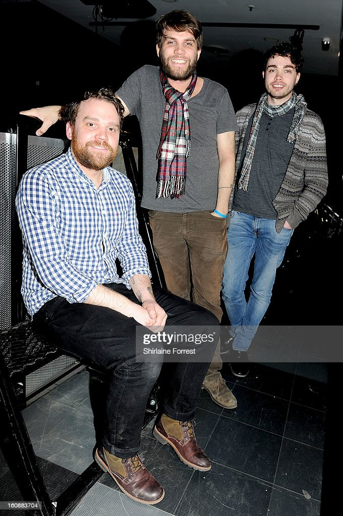 Scott Hutchison, Grant Hutchison and Gordon Skene of Frightened Rabbit pose after performing live and signing copies of their new album 'Pedestrian Verse' at HMV Market Street on February 6, 2013 in Manchester, England.
