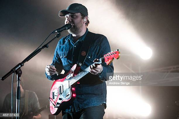 Scott Hutchison of Frightened Rabbit performs on stage at Kendal Calling Festival at Lowther Deer Park on August 3 2014 in Kendal United Kingdom