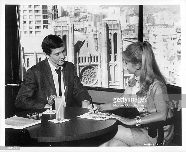 Scott Hylands And Carol White sit at table in a scene from the film 'Daddy's Gone A Hunting' 1969