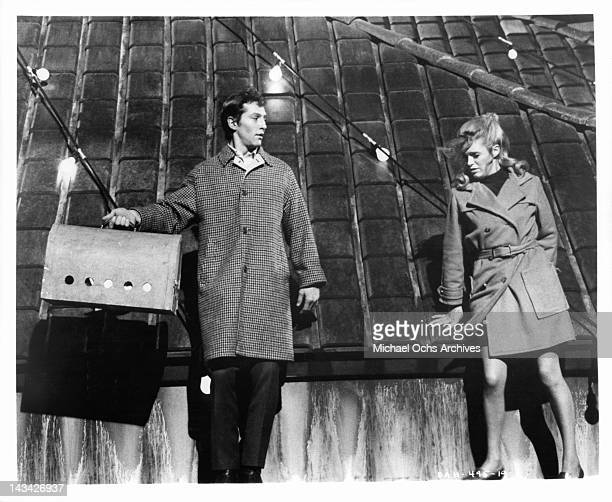 Scott Hylands and Carol White walking on a narrow high ledge in a scene from the film 'Daddy's Gone AHunting' 1969