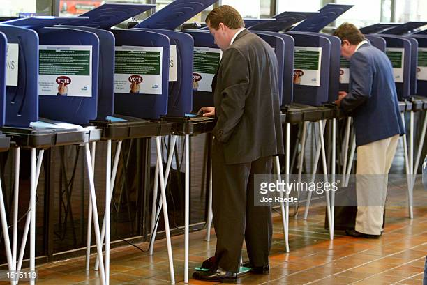 Scott Jackson casts his ballot on the new touchscreen machines at one of 14 polling places open to registered MiamiDade voters before the November 5...