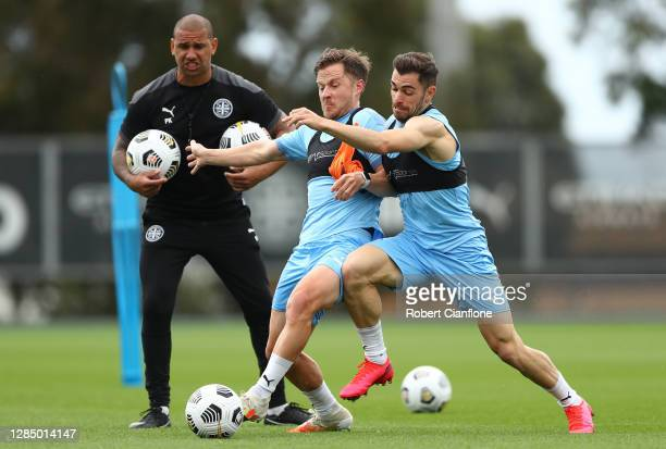 Scott Jamieson and Ben Garuccio of Melbourne City compete for the ball during a Melbourne City A-League training session at City Football on November...