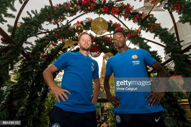 Scott Jamieson and Bruce Kamau of Melbourne City pose at the Christmas site during an ALeague media opportunity at Federation Square on December 18...