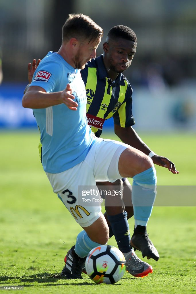 Scott Jamieson of City contests the ball with Kwabena Appiah of the Mariners during the round 16 A-League match between the Central Coast Mariners and Melbourne City at Central Coast Stadium on January 14, 2018 in Gosford, Australia.