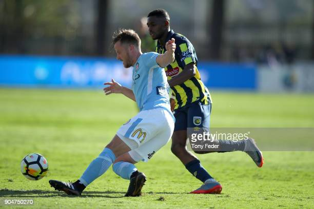 Scott Jamieson of City contests the ball with Kwabena Appiah of the Mariners during the round 16 ALeague match between the Central Coast Mariners and...