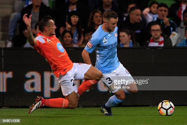 Scott Jamieson of Melbourne City about to get tackled by Eric Bautheac of Brisbane Roar during the ALeague Elimination Final match between the...
