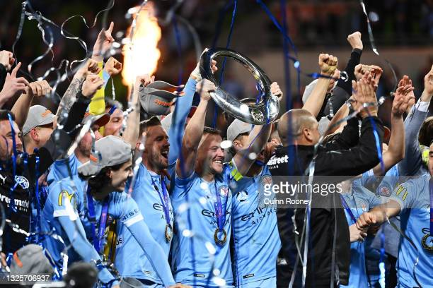 Scott Jamieson of Melbourne City celebrates victory with team mates and holds aloft the A-League trophy during the A-League Grand Final match between...