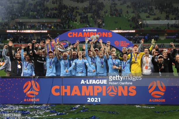 Scott Jamieson of Melbourne City celebrates victory with team mates and holds aloft the A-League trophy after winning the A-League Grand Final match...