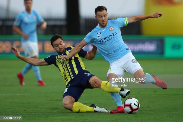 Scott Jamieson of Melbourne City contests the ball with Tommy Oar of the Central Coast Mariners during the round 12 ALeague match between the Central...