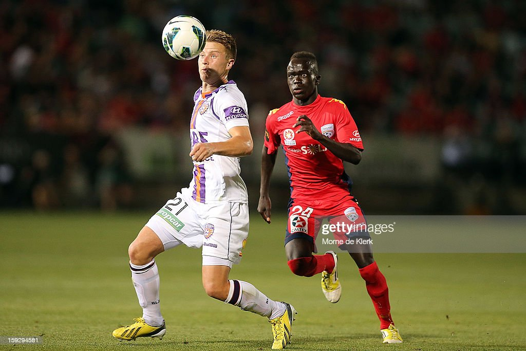Scott Jamieson of Perth gets away from Awer Mabil of Adelaide during the round 16 A-League match between Adelaide United and the Perth Glory at Hindmarsh Stadium on January 11, 2013 in Adelaide, Australia.