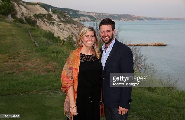 Scott Jamieson of Scotland and his wife Natalie Jamieson pose for a photograph following practice for the Volvo World Match Play Championship at...