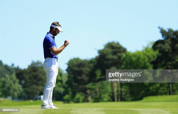 Scott Jamieson of Scotland celebrates a birdie putt on the 9th green during day two of the BMW PGA Championship at Wentworth on May 26 2017 in...