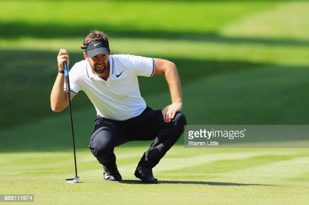 Scott Jamieson of Scotland lines up a putt on the 15th hole during day one of the BMW PGA Championship at Wentworth on May 25 2017 in Virginia Water...
