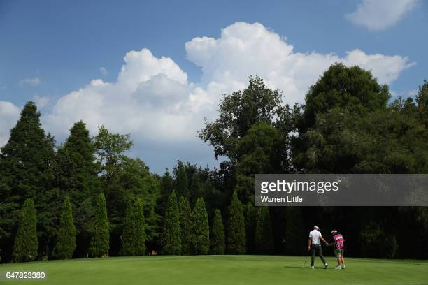Scott Jamieson of Scotland passes his ball to his caddie on the 12th green during the third round of the Tshwane Open at Pretoria Country Club on...