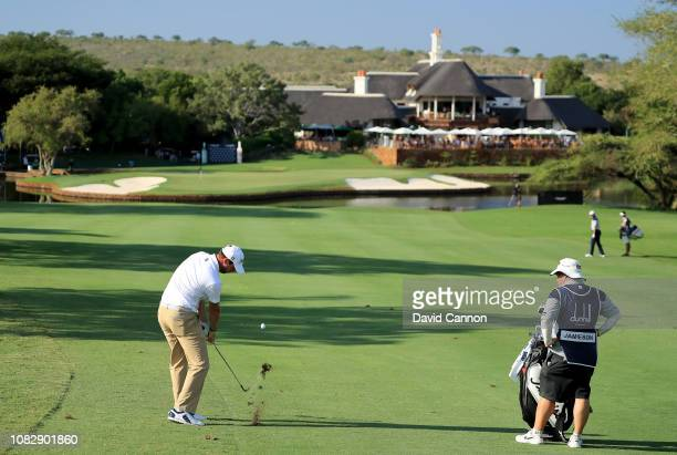 Scott Jamieson of Scotland plays his second shot on the par 5 18th hole during the third round of the Alfred Dunhill Championships at Leopard Creek...