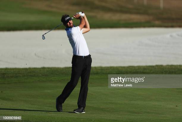 Scott Jamieson of Scotland plays his third shot on the 11th hole during day two of the Porsche European Open at Green Eagle Golf Course on July 27...