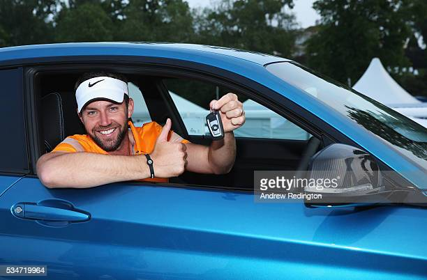 Scott Jamieson of Scotland poses in his new BMW M2 car after his holeinone on the 10th during day two of the BMW PGA Championship at Wentworth on May...