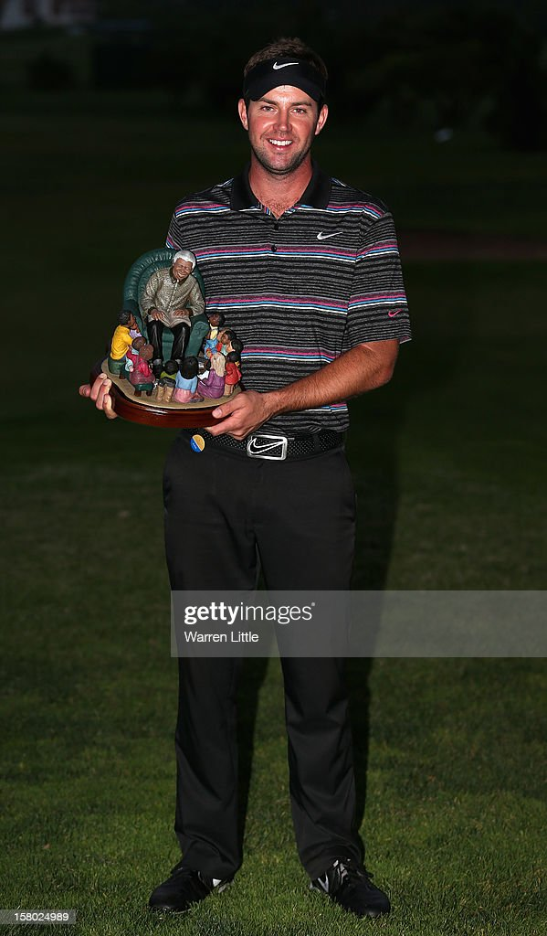 Scott Jamieson of Scotland poses with the trophy after winning The Nelson Mandela Championship presented by ISPS Handa after a three way play-off against Steve Webster of England and Eduardo de la Riva of Spain at Royal Durban Golf Club on December 9, 2012 in Durban, South Africa.