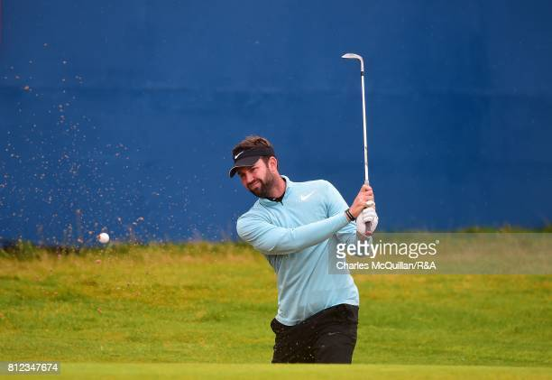 Scott Jamieson of Scotland splashes out from the 18th bunker during the Dubai Duty Free Irish Open hosted by the Rory Foundation at Portstewart Golf...