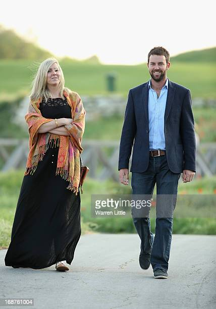 Scott Jamieson of Scotland walks with his wife Natalie Jamieson ahead of the Volvo World Match Play Championship at Thracian Cliffs Golf Beach Resort...
