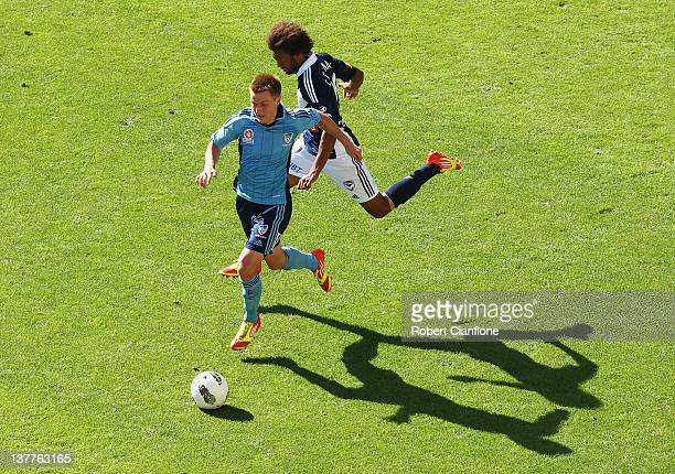 Scott Jamieson of Sydney FC is chased by Isaka Cernak of the Victory during the round 17 A-League match between the Melbourne Victory and Sydney FC...