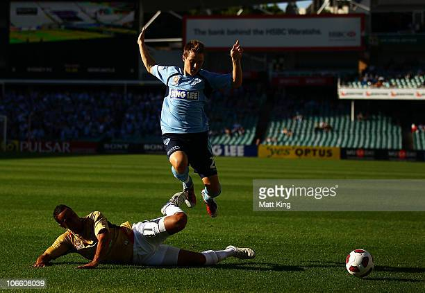 Scott Jamieson of Sydney jumps to avoid Tarek Elrich of the Jets in a tackle during the round 13 ALeague match between Sydney FC and the Newcastle...
