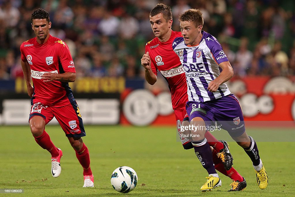 Scott Jamieson of the Glory looks to pass the ball during the round twenty seven A-League match between Perth Glory and Adelaide United at nib Stadium on March 30, 2013 in Perth, Australia.