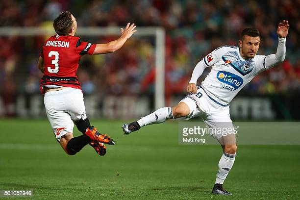 Scott Jamieson of the Wanderers is tackled by Kosta Barbarouses of Melbourne Victory during the round 10 ALeague match between the Western Sydney...