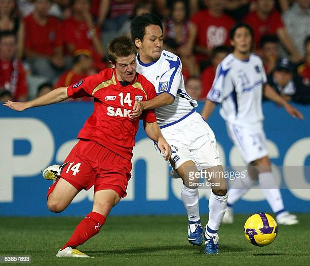 Scott Jamieson of United competes for the ball with Takahiro Futagawa of Osaka during the AFC Champions League Final second leg match between...