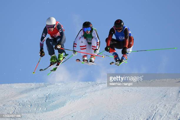 Scott Johns of Great Britain Marcus Plank of Austria and Robin Tissieres of Switzerland compete in Men's ski cross in freestyle skiing during day 10...