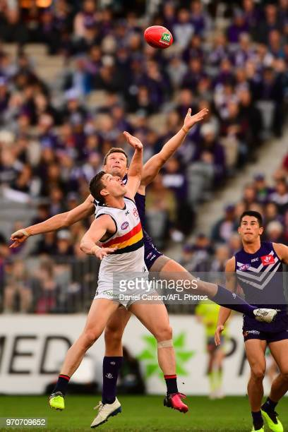 Scott Jones of the Dockers contests a ruck with Josh Jenkins of the Crows during the 2018 AFL round 12 match between the Fremantle Dockers and the...