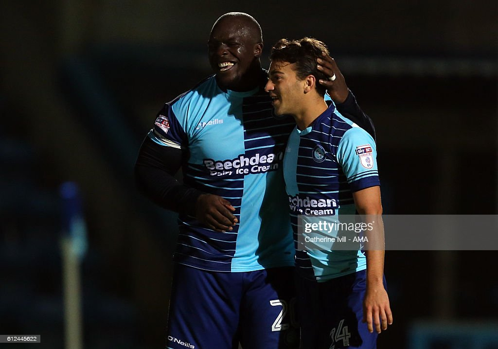 Scott Kashket of Wycombe Wanderers celebrates after scoring to make it 2-0 with Adebayo Akinfenwa of Wycombe Wanderers during the Checkatrade trophy match between Wycombe Wanderers and West Ham United at Adams Park on October 4, 2016 in High Wycombe, England.