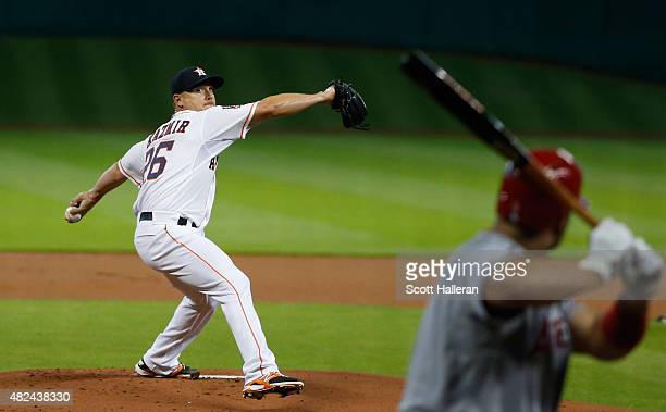 Scott Kazmir of the Houston Astros throws a pitch in the first inning to Albert Pujols of the Los Angeles Angels of Anaheim during their game at...