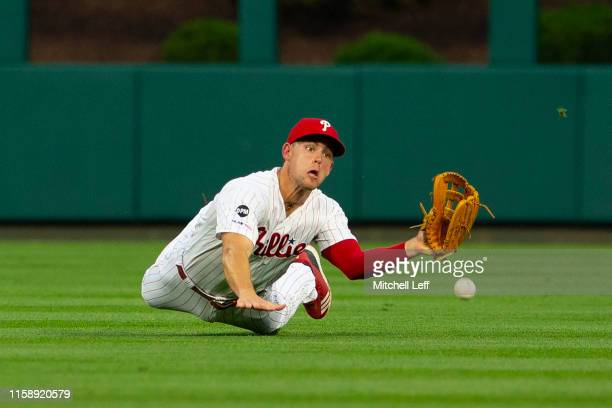 Scott Kingery of the Philadelphia Phillies dives but cannot make the catch on a ball hit by Austin Slater of the San Francisco Giants in the top of...
