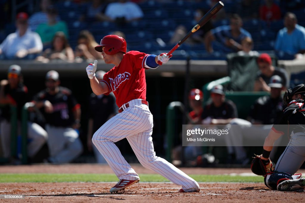 Scott Kingery #80 of the Philadelphia Phillies hits a single during the first inning against the University of Tampa during the Spring Training at Spectrum Field on February 22, 2018 in Milwaukee, Wisconsin.