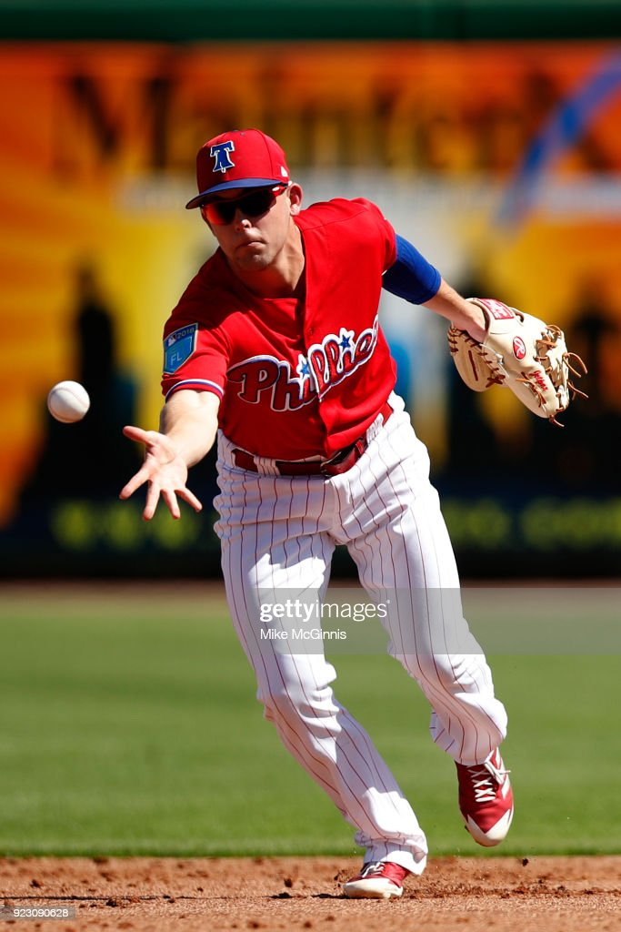 Scott Kingery #8 of the Philadelphia Phillies makes the flip to second base against the University of Tampa during the the Spring Training game at Spectrum Field on February 22, 2018 in Milwaukee, Wisconsin.