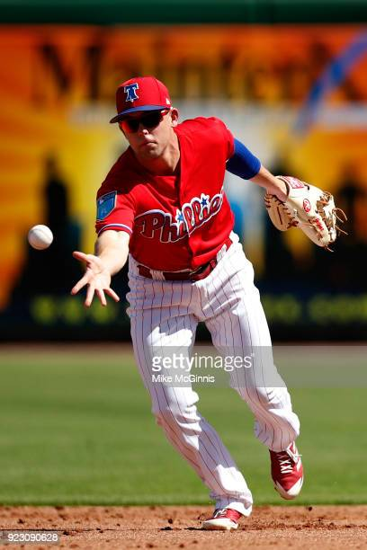 Scott Kingery of the Philadelphia Phillies makes the flip to second base against the University of Tampa during the the Spring Training game at...