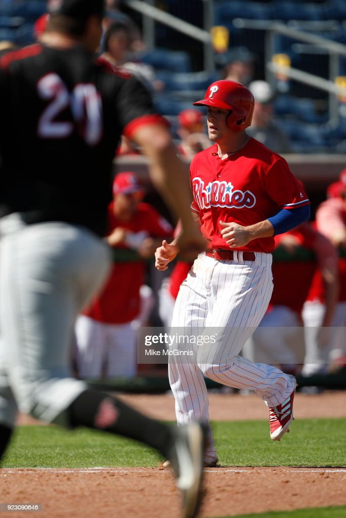 Scott Kingery #80 of the Philadelphia Phillies reaches on a 2 RBI single hit by Danny Ortiz against the University of Tampa during the forth inning of the Spring Training game at Spectrum Field on February 22, 2018 in Milwaukee, Wisconsin.