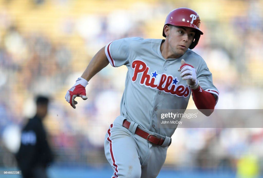 Scott Kingery #4 of the Philadelphia Phillies rounds third base on his way to scoring in the seventh inning against Los Angeles Dodgers at Dodger Stadium on May 31, 2018 in Los Angeles, California. Philadelphia Phillies won 2-1.